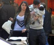 Lionel Messi with his girlfriend and son