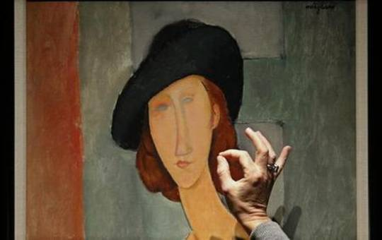 Portrait of Jeanne Hebuterne painted by Italian artist Amedeo Modigliani