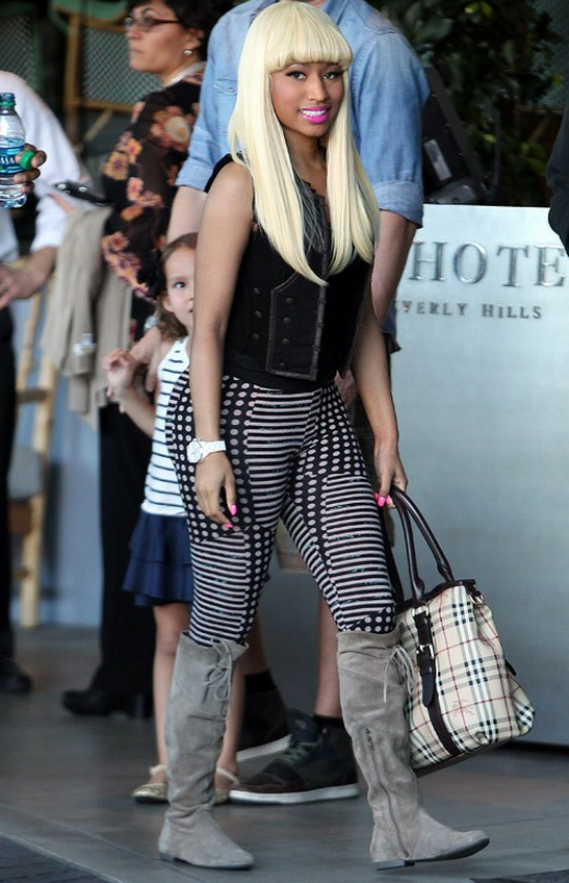 She owns this famous luxurious Burberry Haymarket Check Tote Bag