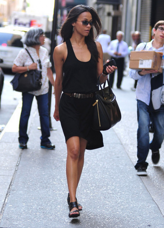 This zingy dress is worn by Zoe Saldana who looks cool sauntering around in it.