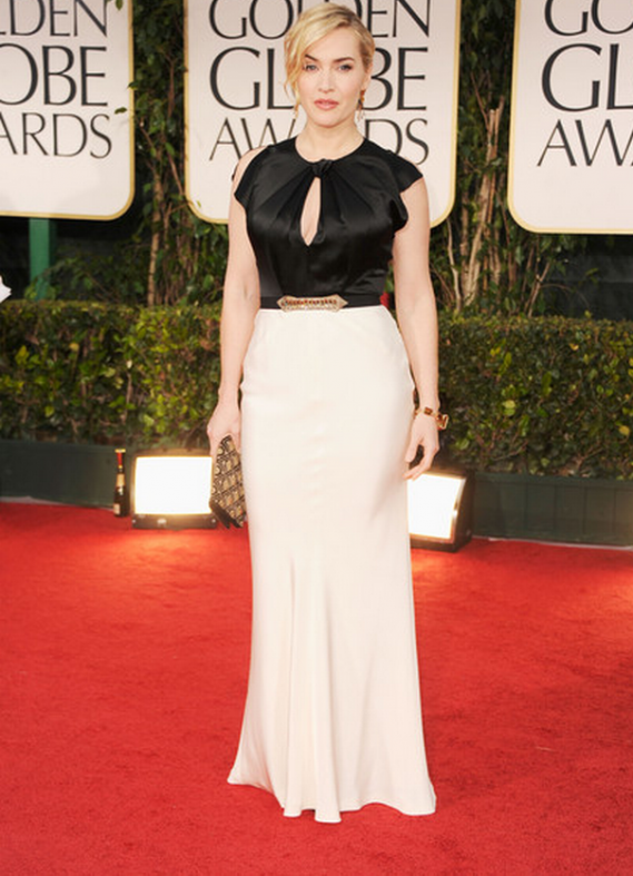 At the 69th Golden Globe Awards. Ms. Winslet wore a large, citrine, 18k gold bracelet from Fred Leighton.