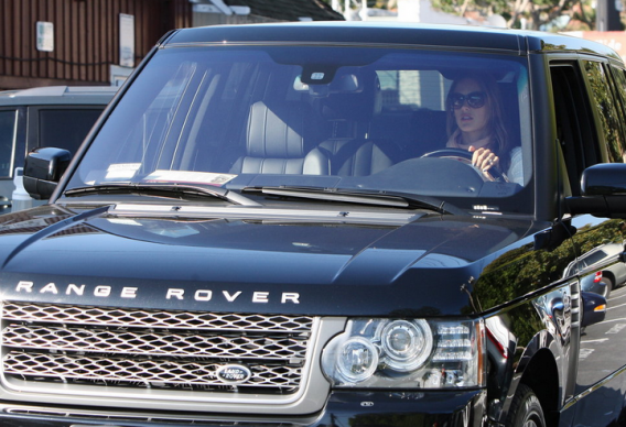 The supermodel was recently photographed parking her metallic black Range Rover while out on a shopping trip.