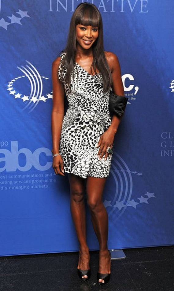 The supermodel was seeing wearing Issa black/white printed one shoulder dress while attending the 2009 Clinton Global Initiative dinner at New York.