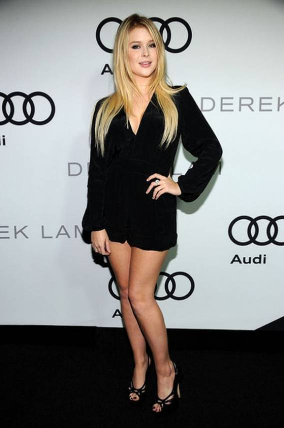 Rebecca Renee Olstead wears Motel Silky Surplice Jet Romper