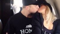 Paris Hilton and River Viiperi share a smooch