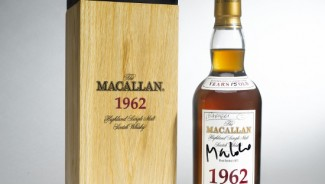 Macallan 1962 bottle of whisky signed by James Bond and Skyfall cast on auction