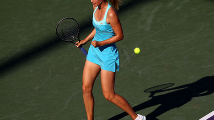 In one of her game tournaments, Maria Sharapova was spotted wearing the Cross Court Statement Women's Tennis dress.