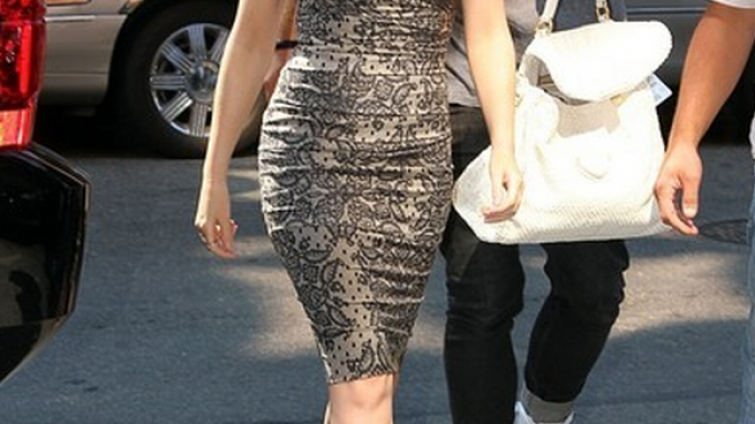 The Australian singer was spotted wearing a Dolce & Gabbana Lace-Print Stretch Silk dress.