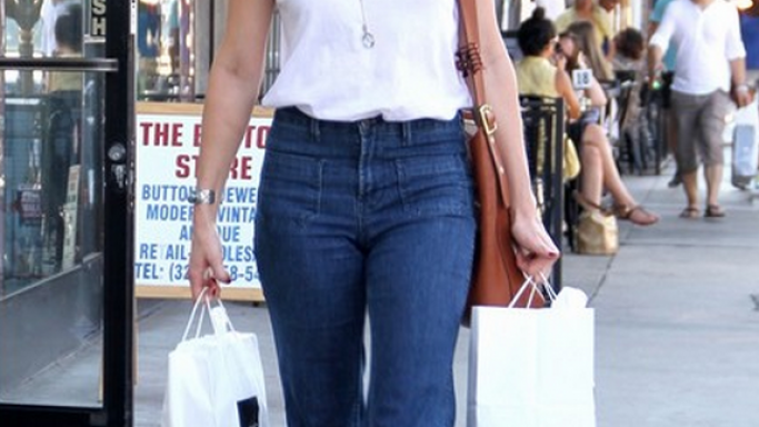 For shopping, Ms.Heard chose the wide-legged, high rise jeans from J Brand to go along with her clean-white top.