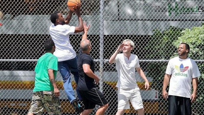 Kanye West playing Basketball