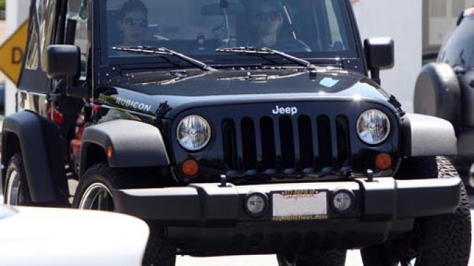 Jeep Wrangler car - Color: Black  // Description: graceful