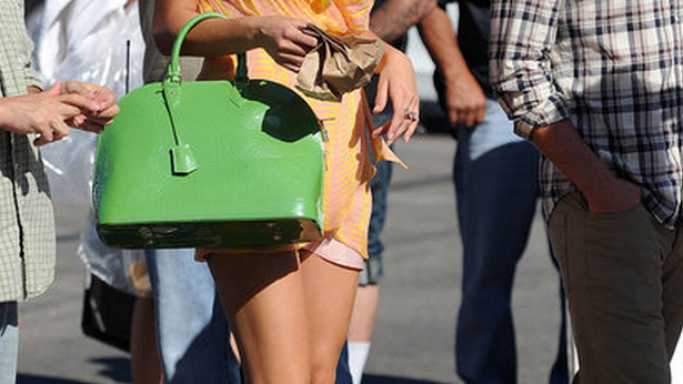 Blake Lively donned her Louis Vuitton Vernis Alma bag at several occassions