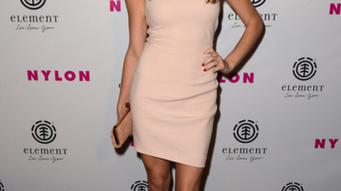 Cover girl Ashley Greene showed up at the launch party for Nylon magazine's August issue with a rather sexy 'Miss Loubi' clutch.