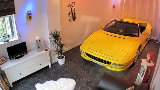 Ferrari fan parks his beloved F355 Spider inside the living room