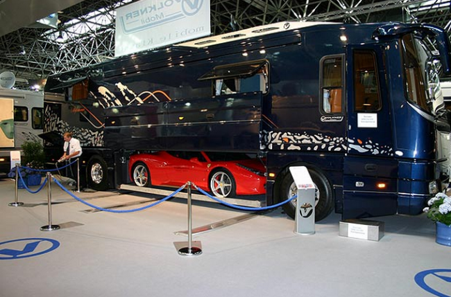 Volkner mobile unveils luxurious motorcoach with built in for Motorcoach with garage